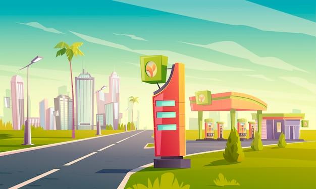 Stacja benzynowa i ładująca z pompą oleju, kablem z wtyczką do samochodu elektrycznego, wyświetlaczem targów i cen na drodze do tropikalnego miasta