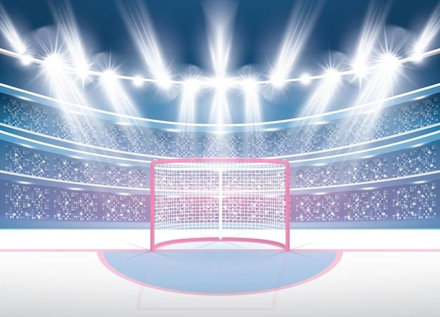 Stadion hokejowy z reflektorami i czerwoną bramką.