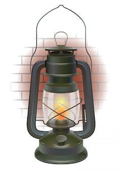 Stara lampa naftowa na fragmencie ściany z cegieł.
