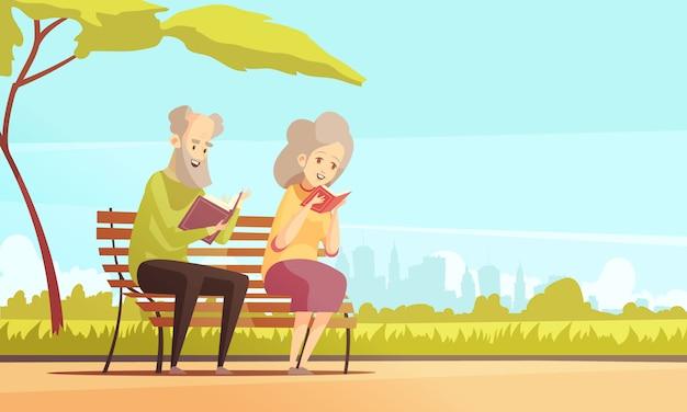 Stara para czyta w parku