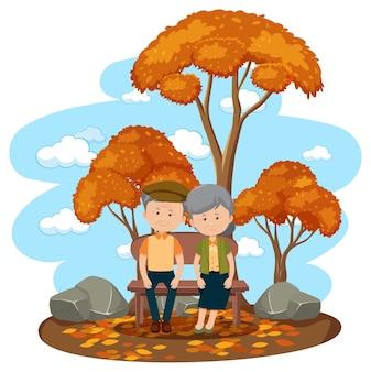 Stara para zakochanych siedzi w parku na białym tle