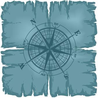 Stara uszkodzona kartka papieru z różą kompasu.