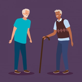 Starcy z przypadkowymi ubraniami i laską