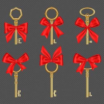 Stare złote klucze z wiązaną czerwoną kokardą na przezroczystym tle