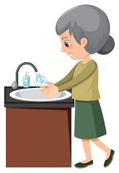 Starsza pani myje ręce