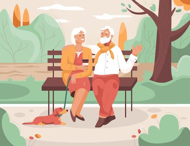 Starsza para odpoczywa w parku miejskim babcia i dziadek