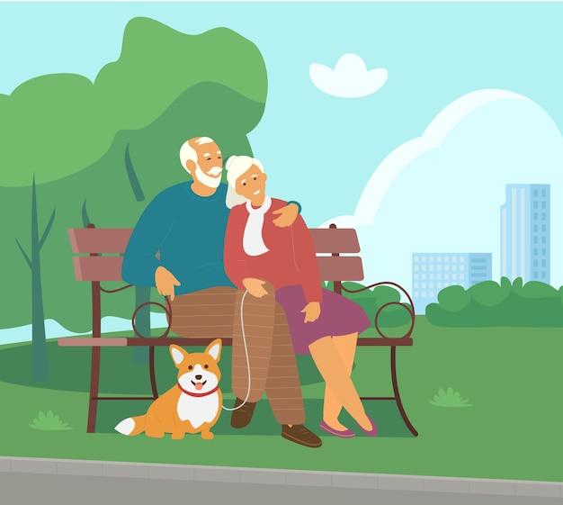 Starsza para siedzi na ławce w parku z płaskim pies corgi.