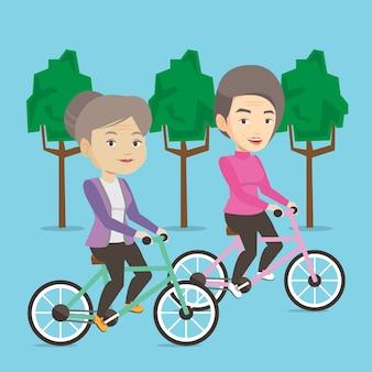 Starsze kobiety jedzie na bicyklach w parku