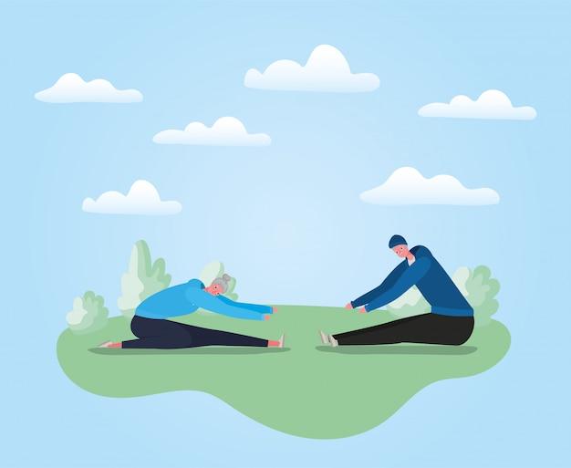 Starszy kobieta i mężczyzna bajki robi joga w projektowaniu parku, temat działania
