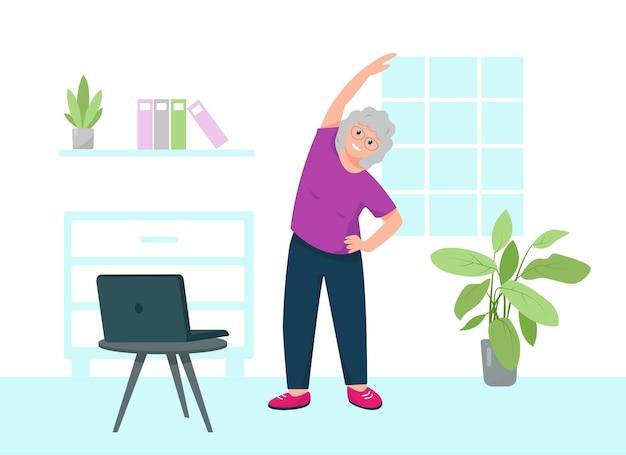 Starszy kobieta robi ćwiczenia sportowe online, przebywa w domu