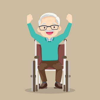 Starszy mężczyzna siedzący na wózku inwalidzkim podnoszący ręcesenior na wózku inwalidzkim