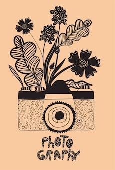 Stary aparat w stylu doodle z kwiatami. .
