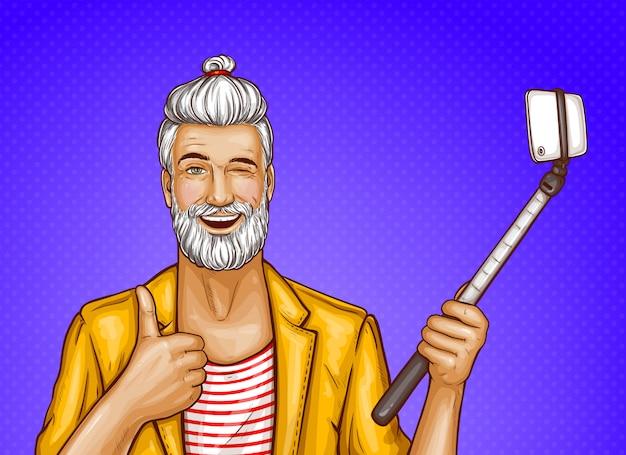 Stary człowiek z kijem selfie i smartphone
