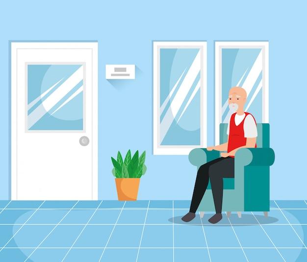 Stary człowiek z ochroną dróg oddechowych w poczekalni