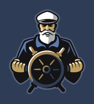 Stary kapitan marynarz trzyma kierownicę statku.