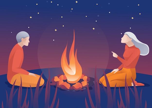 Stary mężczyzna i kobieta siedząca w pobliżu kreskówka ognisko