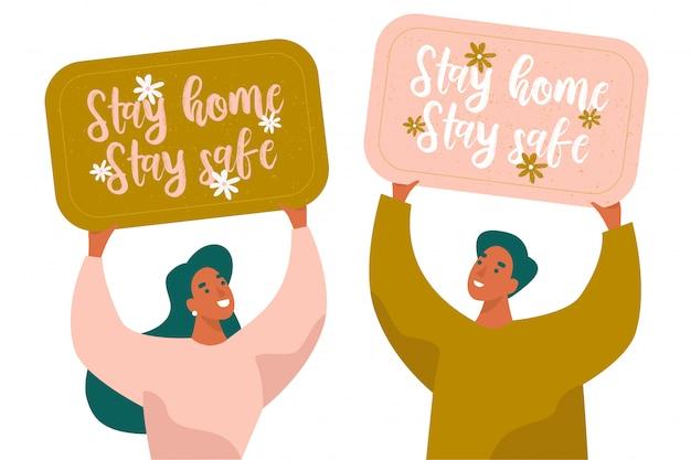 Stay home stay safe banery z napisem. dwie osoby posiadające banery. kwarantanna, wezwanie do okresu izolacji.