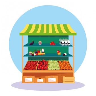 Stoisko kiosku z warzywami i owocami w sklepie
