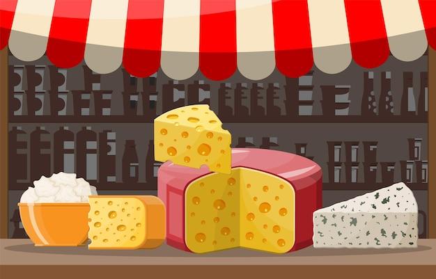 Stoisko w sklepie z serem. sklep rolniczy lub lada wystawowa. całość i kawałek sera na białym tle. mleczny produkt mleczny. zdrowa żywność ekologiczna. ilustracja wektorowa w stylu płaski
