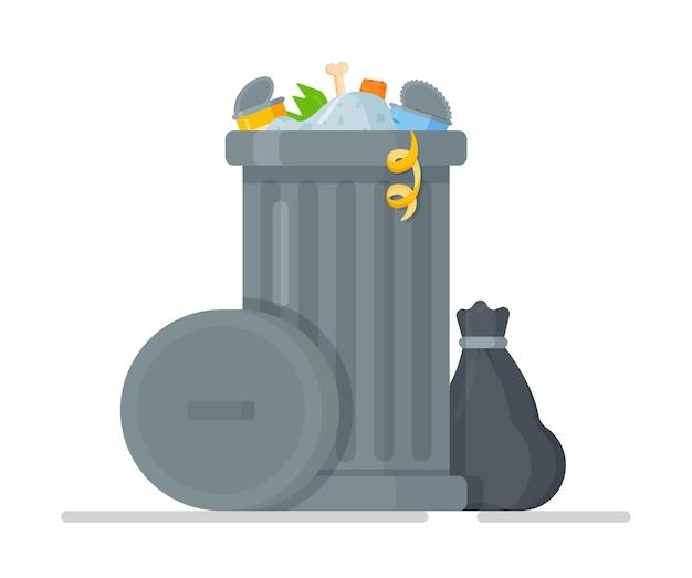 Stojący obok kosz na śmieci z zebranymi śmieciami.