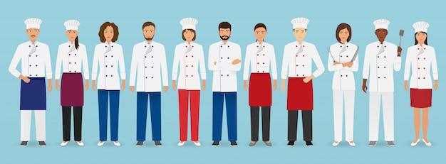 Stojący w mundurze zespół zajmujący się obsługą gastronomiczną. grupa postaci gastronomicznych szefa kuchni, kucharza, kelnerów i barmana.