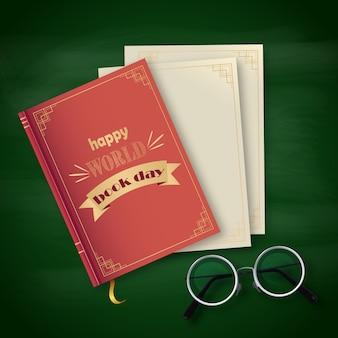 Stos książek, szczęśliwy światowy dzień na zielonym tle