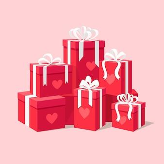 Stos pudełka na prezenty z sercem. szczęśliwych walentynek
