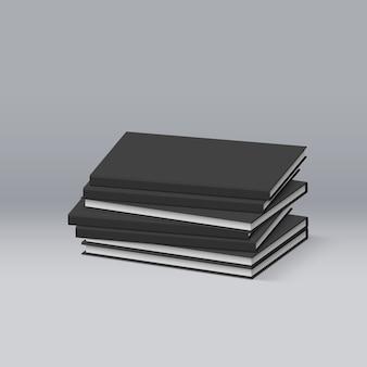 Stos pustych czarnych książek. prezentacja twojej marki i tożsamości