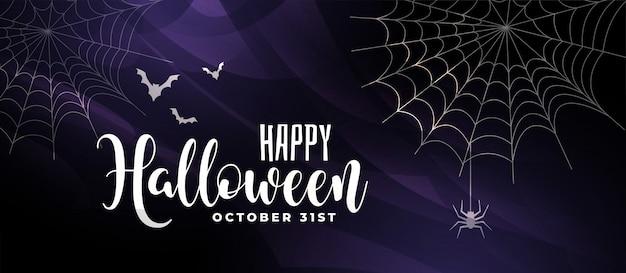 Straszny halloween tło z nietoperzami i pająk siecią