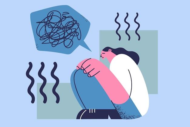 Stres, depresja, pojęcie żalu. młoda kobieta kreskówka siedzi na podłodze ze złymi myślami, przygnębiony zdezorientowany