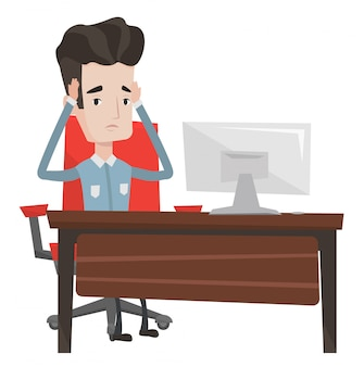 Stresujący pracownik siedzi w miejscu pracy.