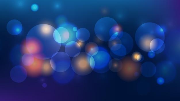 Streszczenie bokeh światło na ciemnym niebieskim tle