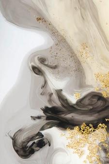 Streszczenie czarne tło akwarela i złoty brokat