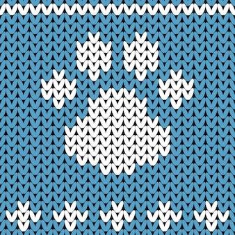 Streszczenie dzianiny wzór łapy psa. winer knit tekstura na nowy rok, papier pakowy wesołych świąt.