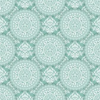 Streszczenie geometryczny wzór z kwiatowymi elementami.