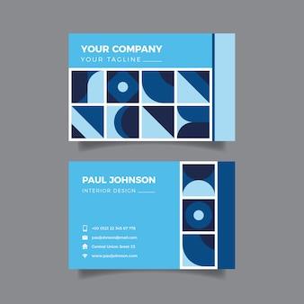 Streszczenie niebieska karta firmy o geometrycznych kształtach