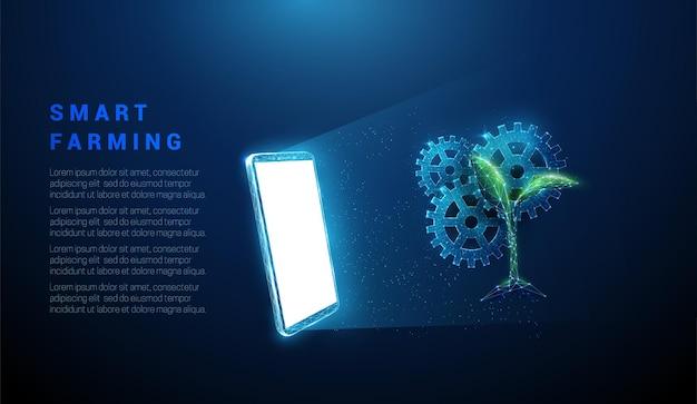 Streszczenie niebieski telefon komórkowy, biały ekran, koło zębate i roślina.