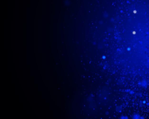 Streszczenie niewyraźne okrągły niebieski bokeh na ciemnym tle.