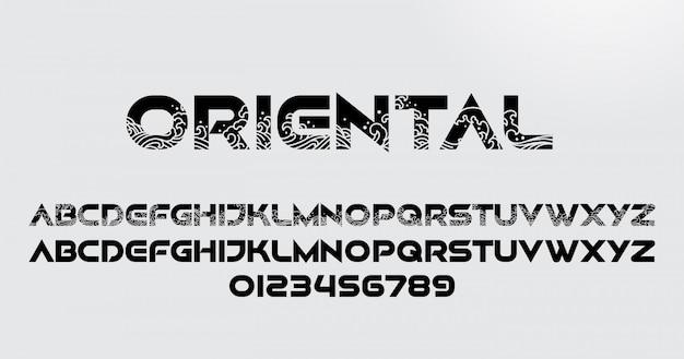 Streszczenie orientalne czcionki i cyfry alfabetu z fal oceanu orient