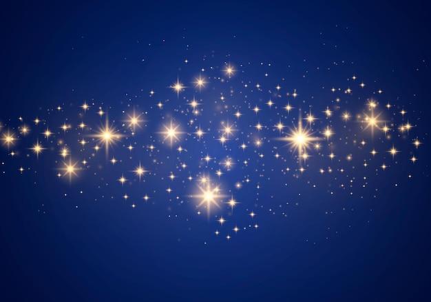 Streszczenie stylowy efekt świetlny na niebieskim tle. żółty pył, żółte iskry i złote gwiazdy świecą specjalnym światłem. wektor luksusowe błyszczy musujące magiczne cząsteczki kurzu.