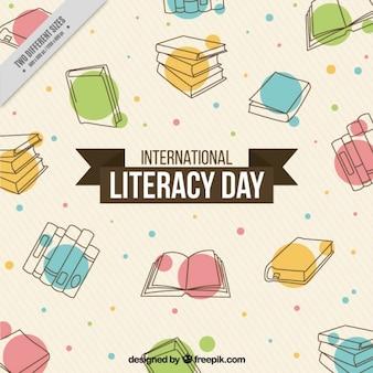 Streszczenie tle wyciągnąć rękę książek na dzień alfabetyzacji