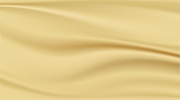 Streszczenie tło czyste luksusowe szmatki lub faliste fałdy złotej tkaniny tekstury tła.