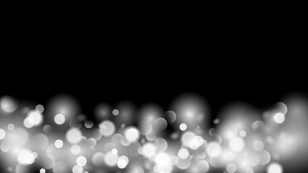 Streszczenie tło z efektem bokeh. niewyraźne, nieostre światła w białych kolorach. białe światła bokeh na czarnym tle.