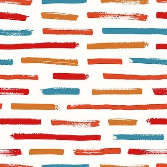 Streszczenie wzór z pociągnięciami pędzla czerwony, pomarańczowy i niebieski