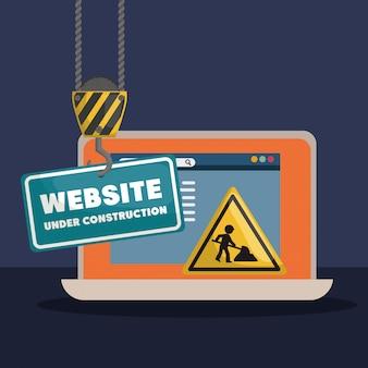 Strona w budowie z laptopem