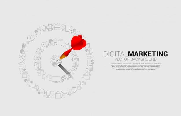 Strzałka dart uderzyła w środek tarczy z ikoną marketingu. koncepcja biznesowa celu marketingowego i klienta