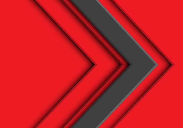 Strzałka szary kierunek na czerwonym tle.