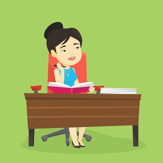 Student pisze przy biurku.