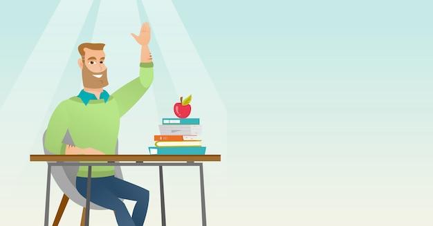 Student podnosi rękę w klasie, aby uzyskać odpowiedź.
