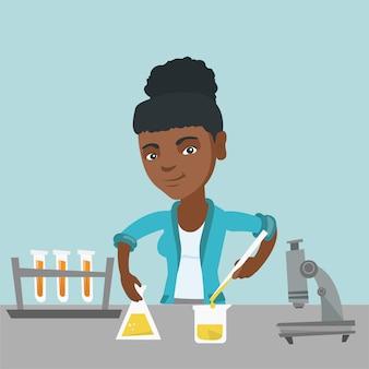 Student przeprowadza eksperyment w klasie laboratoryjnej.